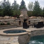 Outdoor Living Space - Brick Fireplace, Retaining Wall, Pool